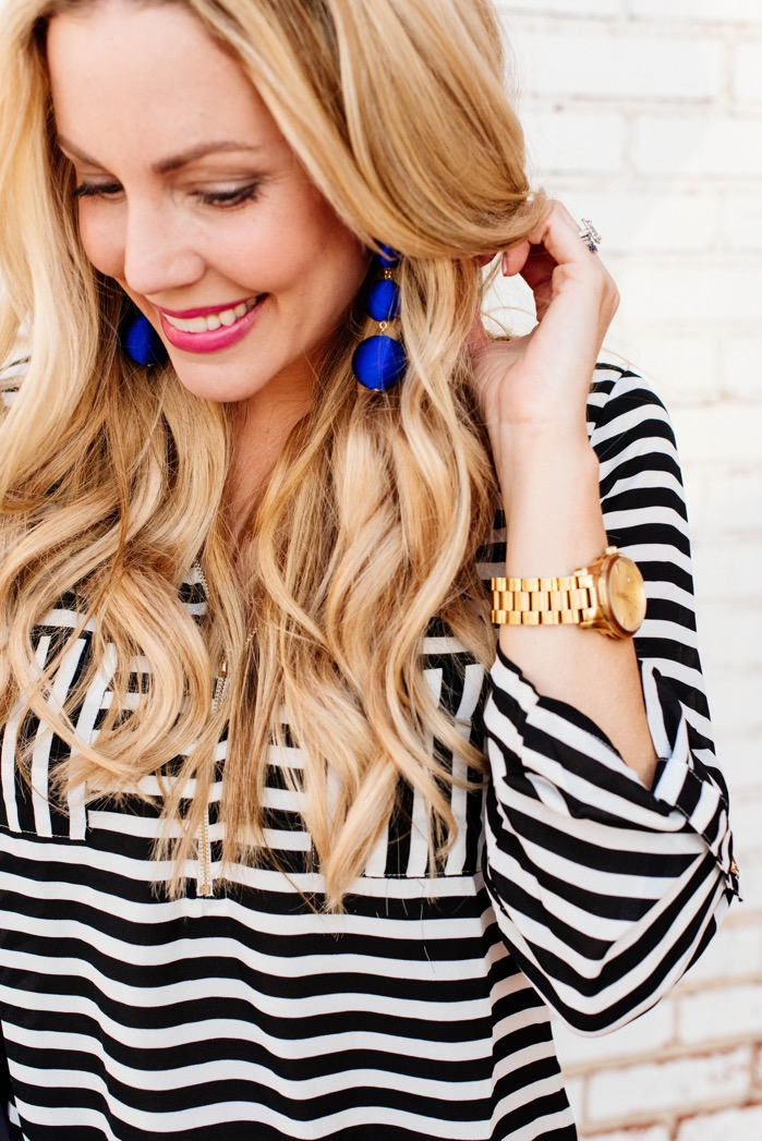 spring outfit ideas crisping earrings bauble bar black white striped top blonde hair loose waves