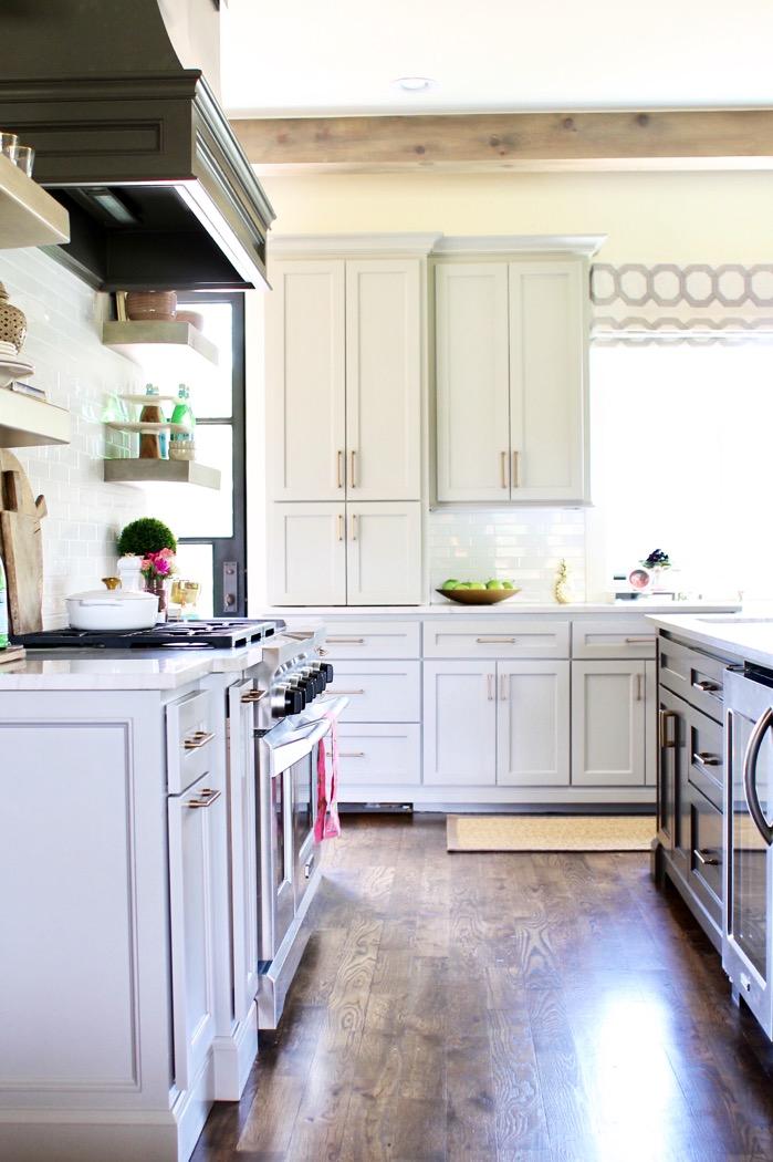 grey kitchen custom cabinets brass hardware wood floors jacobean stain