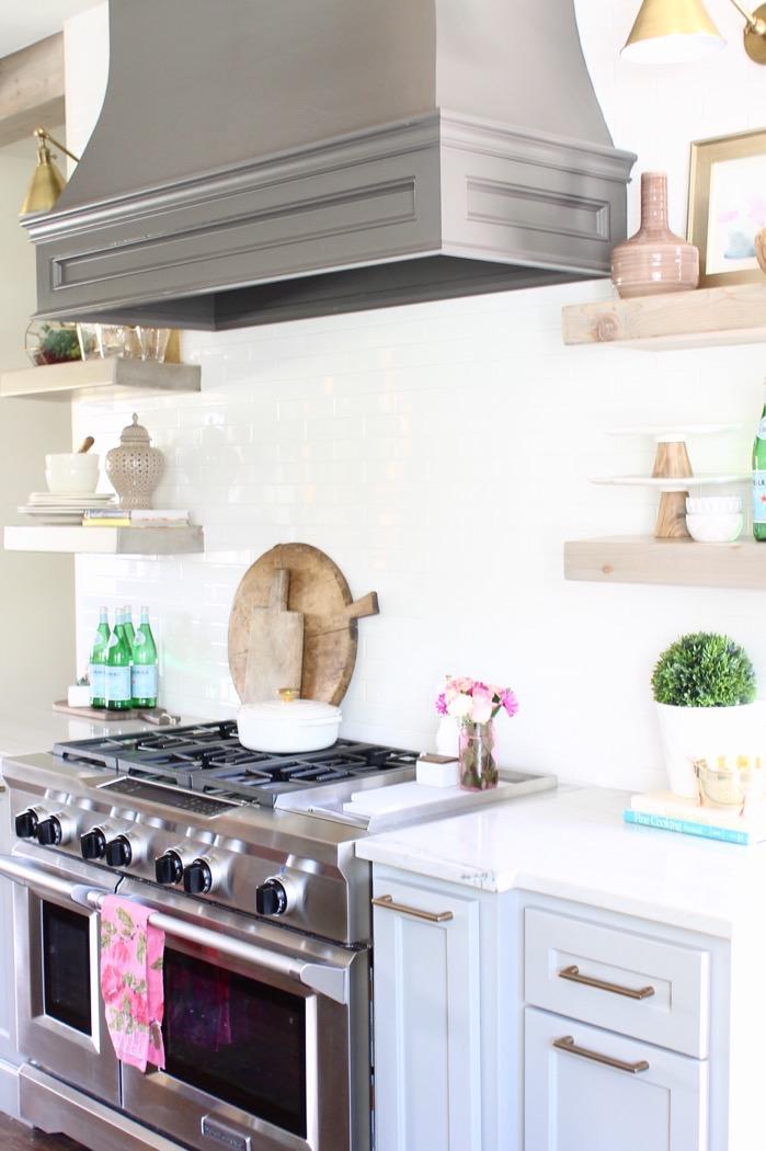 kitchenaid professional range white backsplash quartzite countertops